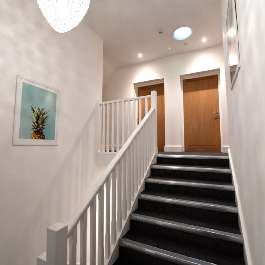 The main staircase at The Coach House