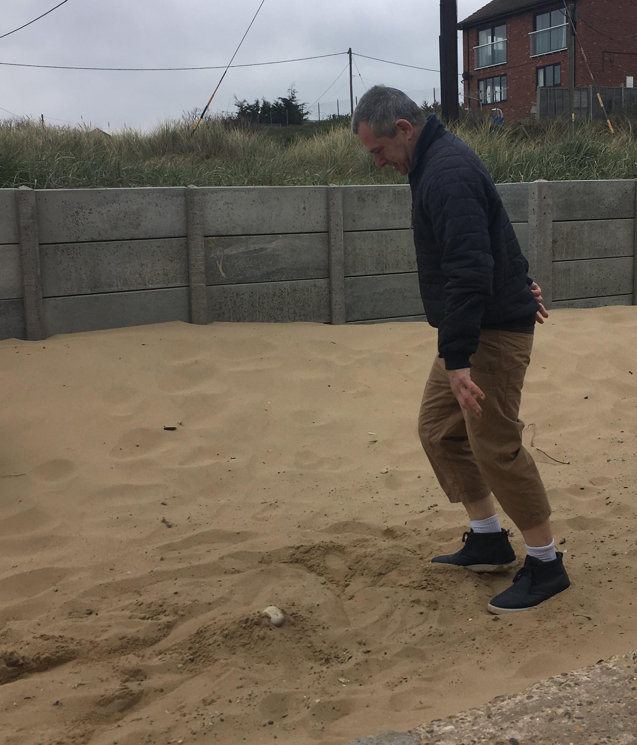 John in sand